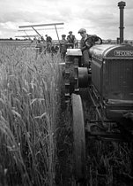 Country life. Tractor and harvester. Beauce region (France), 1931. Photograph by François Kollar (1904-1979). Paris, Bibliothèque Forney. © François Kollar/Bibliothèque Forney/Roger-Viollet