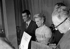 """Jacqueline Auriol (1917-2000, au centre), aviatrice francaise, et René Floriot (1902-1975, à droite), avocat français, lors la remise des prix de """"La fondation de la Vocation"""". Paris.    © Roger-Viollet"""