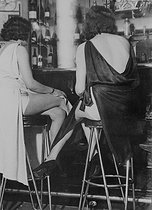 "Prostitutes at the bar of the ""Sphinx"" brothel, boulevard Edgar-Quinet. Paris (XIVth arrondissement), circa 1930. © Roger-Viollet"