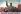 """Mao Zedong (1893-1976) guidant le peuple chinois, avec ce slogan : """"Tous unis pour obtenir de plus grandes victoires"""". Affiche pendant la Révolution culturelle. 1965. © Roger-Viollet"""