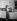 Jeune femme dans sa cuisine.  © Roger-Viollet