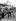 Henri Roger reassembling a bike, 1894.  © Henri Roger / Roger-Viollet