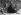 """""""Clocharde assise sur un tas de pavés"""", 1900-1902. Photographie de Louis Vert (1865-1924). Paris, musée Carnavalet. © Louis Vert/Musée Carnavalet/Roger-Viollet"""