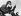 Jeune femme se maquillant au guidon de sa moto. Vers 1935. © Roger-Viollet