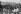 Temita Tassende visitant la caserne de la Moncada (où son père José Luis Tassende fut tué), avec d'autres étudiants. Santiago de Cuba, 15 juillet 1963. © Gilberto Ante/Roger-Viollet