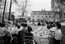 Meal during the christening of Anthony Delon, son of Alain and Nathalie Delon, on May 1st, 1966. Photograph by Georges Kelaïditès (1932-2015). © Georges Kelaïditès / Roger-Viollet