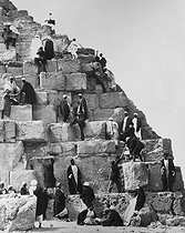 Tourists climbing on the Great Pyramid of Khufu. Giza (Egypt), circa 1900. © Roger-Viollet