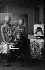 Giorgio de Chirico (1888-1978), peintre italien, devant une de ses oeuvres. Paris, vers 1930. © Boris Lipnitzki/Roger-Viollet
