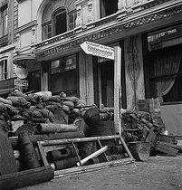 World War II. Liberation of Paris. Barricades blocking the rue de Richelieu, in front of the boulevard des Italiens, near the Kommandantur located at the place de l'Opéra. Paris (IXth arrondissement), August 19-24, 1944. Photograph by Jean Roubier (1896-1981). © Fonds Jean Roubier/Roger-Vio