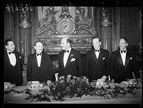 "World War II. Camille Chautemps (second from the left, 1885-1971), French politician, making a speech about the birth anniversary of George Washington (1732-1799), first President of the United States, during a banquet organized at the American Club by the American people living in Paris. His speech also mentioned the efforts from France and the United States in order to keep on defending the civilization and progress of humanity. On his right : Ronald Campbell (1883-1953), British ambassador in France, and Georges Bonnet (1889-1973), French Minister for Justice. Paris (XVIth arrondissement), on February 22, 1940. Photograph from the collections of the French newspaper ""Excelsior"". © Excelsior - L'Equipe / Roger-Viollet"