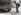 """Les """"A"""" (""""Austria"""") sur les voitures sont remplacés par des """"D"""" (""""Deutschland""""), après l'Anschluss. Autriche, 1938. © Imagno / Roger-Viollet"""