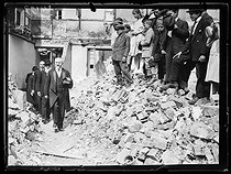"Raymond Poincaré (1860-1934), President of the French Republic, walking among the ruins of the rue de l'Université, on the occasion of the presentation of the Cross of the Legion of Honour to the city of Reims (France), on July 6, 1919. Photograph published in the newspaper ""Excelsior"" on July 7, 1919. © Excelsior - L'Equipe / Roger-Viollet"