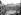 La cour de l'hôtel de Rohan-Soubise donnant sur la rue des Francs-Bourgeois, occupé par l'Imprimerie nationale, avec la statue de Gutenberg. Paris (IIIème arr.), 1910. © Roger-Viollet