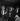 Georges Cravenne, press and public relations agent. In the background: Alain Delon. Paris, Saint-Hilaire Club, 1962. © Noa / Roger-Viollet