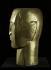 """Ossip Zadkine (1890-1967). """"Tête d'homme"""". Bois doré à la feuille, 1922. Paris, musée Zadkine. © F. Cochennec, E. Emo / Musée Zadkine / Roger-Viollet"""