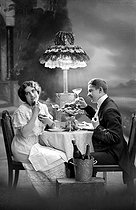 Supper with champagne, fancy postcard, about 1910. © Neurdein/Roger-Viollet