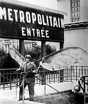 Man with hang gliders. Concours Lépine, French invention competition. Paris, 1935. © Jacques Boyer/Roger-Viollet