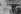 """Guerre 1939-1945. Front de Normandie. Panneaux indicateurs routiers en allemand et pancarte indiquant """"tout pillard sera puni de mort"""" et """"toute réquisition est interdite sans l'autorisation du Kampfkommandant"""". Lisieux, juillet 1944. © LAPI/Roger-Viollet"""