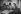 Guerre 1939-1945. Alsaciens lisant un journal relatant la libération de Strasbourg. France, 1944. © Neurdein/Roger-Viollet