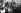 Guerre 1939-1945. Enfants survivants sortant du camp de concentration d'Auschwitz guidés par des soignantes. Auschwitz (Pologne), 1945. © Ullstein Bild/Roger-Viollet