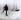 """Fridtjof Nansen (1861-1930), explorateur norvégien, debout sur la banquise et regardant son bateau, le """"Fram"""", lors d'une expédition polaire, vers 1895. Diapositive de verre coloriée à la main. © Imagno/Roger-Viollet"""
