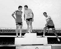 Podium of the 1964 Tour de France. From left to right : Raymond Poulidor (second), Jacques Anquetil (first), French racing cyclists, and Federico Bahamontès (third), Spanish racing cyclist. Paris, Parc des Princes. © Roger-Viollet