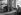 Café owner talking to his customers, at the corner of the rue de Varenne and the boulevard des Invalides. Paris (VIIth arrondissement), 1942. Photograph by René Giton (known as René-Jacques, 1908-2003). Bibliothèque historique de la Ville de Paris. © René-Jacques / BHVP / Roger-Viollet