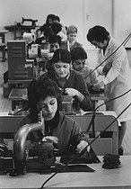 Apprentices and teacher in a professional training workshop of the shoe industry. France, 1971. Photograph by Janine Niepce (1921-2007). © Janine Niepce / Roger-Viollet