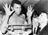 Mohamed Ali (anciennement Cassius Marcellus Clay, 1942-2016), boxeur américain, à la pesée aux côtés de Herman Greenberg et d'Eddie Urbec. Boston (Etats-Unis), 10 novembre 1964. © TopFoto / Roger-Viollet
