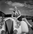 Charles Trenet (1913-2001), chanteur et auteur-compositeur français, posant sur le capot d'un cabriolet Delage carrossé par Figoni-Falaschi. Deauville (Calvados), août 1939. © Boris Lipnitzki / Roger-Viollet