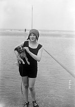 Bather and her dog. Deauville (France), August 1913. © Maurice-Louis Branger / Roger-Viollet