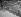 """La Seine. """"Amoureux sur les quais"""". Paris, 1945. Photographie de René Giton dit René-Jacques (1908-2003). Bibliothèque historique de la Ville de Paris. © René-Jacques / BHVP / Roger-Viollet"""