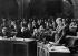 Janos Kadar (1912-1989), homme politique hongrois, prononçant un discours lors d'une séance au Parlement hongrois, en présence notamment de Ferenc Munnich (1886-1967) et Antal Apro (1913-1994), 1958. © Ullstein Bild / Roger-Viollet