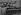 Janos Kadar (1912-1989), homme politique hongrois, de retour d'une assemblée générale des Nations Unies, s'adressant à des ouvriers devant ses ministres. De g. à dr. : Istvan Szirmai, Sandor Hamvas, Antal Apro, Istvan Dobi et Syorgy Marosan, 18 octobre 1960. © TopFoto / Roger-Viollet
