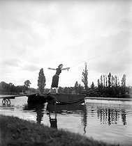 Fly fishing competition. Paris, lake of the bois de Boulogne, 1930s.  © Tony Burnand / Roger-Viollet