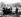 Guerre 1939-1945. Démineurs de la Royal engineers vérifiant la présence de mines sous l'épave d'un char Bren Carrier détruit par une mine. Tilly-sur-Seulles (France), 19 juin 1944. © TopFoto / Roger-Viollet