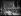 """Albert Lebrun (1871-1950), Président de la République française, sortant de la cathédrale Notre-Dame après la cérémonie funèbre à la mémoire des marins du """"Phénix'"""", sous-marin coulé en mer de Chine, passe devant le drapeau des fusiliers marins qui lui rendent les honneurs. Paris (IVe arr.), juin 1939. Photographie du journal """"Excelsior"""". © Excelsior - L'Equipe / Roger-Viollet"""