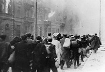 World War II. The Warsaw Ghetto on fire. © Roger-Viollet