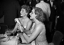 Line Renaud and Patachou, French singers, attending a gala at the Lido. Paris, on June 5, 1953. © Roger-Viollet
