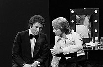 Claude François (1939-1978), French singer, and Michel Drucker (born in 1942), French journalist and television host. Joinville television studio (France), April 1972. © Patrick Ullmann / Roger-Viollet
