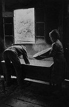 Breadmaking. Kneading trough. Corrèze (France), 1966. Photograph by Jean Marquis (1926-2019). © Jean Marquis / Roger-Viollet