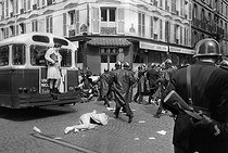 "Events of May-June 1968. Altercation between the police forces and students, during the first violent demonstrations in the Latin Quarter, at the corner of the rue Saint-Jacques and the rue du Sommerard. Paris (Vth arrondissement), on May 6, 1968. Photograph by Jacques Boissay and Bernard Charlet, from the collections of the French newspaper ""France-Soir"". Bibliothèque historique de la Ville de Paris. © Boissay,Charlet / Fonds France-Soir / BHVP / Roger-Viollet"