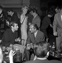 Roger Vadim, Catherine Deneuve, Eddie Barclay and Jean Lefebvre. Paris, Club Saint-Hilaire, 1964. © Roger-Viollet