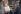 """John Glenn (1921-2016), astronaute, pilote de chasse et homme politique américain, observant le logo qui sera apposé sur la navette spatiale utilisée lors de son vol en orbite au-dessus de la Terre. Ce logo évoque le groupe des """"Mercury Seven"""", les sept astronautes du programme Mercury sélectionnés par la NASA le 9 avril 1959 (Walter Schirra, Donald Slayton, John Glenn et Scott Carpenter. Second rang : Alan Shepard, Virgil Grissom et Gordon Cooper). Cap Canaveral (Floride, Etats-Unis), janvier-février 1962. Photographie : Atlas Photo Archive/NASA. © TopFoto / Roger-Viollet"""