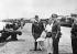 Guerre 1939-1945. Indochine. Le général Gracey et le brigadier Maunsell, officiers anglais venus désarmer les forces japonaises après la capitulation, inspectent les docks de Saïgon en compagnie d'un officier japonais prisonnier. Septembre 1945.  © Roger-Viollet
