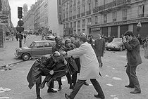 "Events of May-June 1968. Policeman wounded during one of the first violent demonstrations in the Latin Quarter, at the corner of the boulevard Saint-Germain and the rue Saint-Jacques. Paris (Vth arrondissement), on May 6, 1968. Photograph by Jacques Boissay and Bernard Charlet, from the collections of the French newspaper ""France-Soir"". Bibliothèque historique de la Ville de Paris. © Boissay,Charlet / Fonds France-Soir / BHVP / Roger-Viollet"