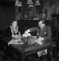 Alain Laubreau, French gastronome eating with his wife. © Pierre Jahan / Roger-Viollet