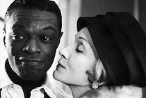 Nat King Cole (1919-1965), American jazz singer and pianist, with Marlene Dietrich (1901-1992), German-born American actress and singer. © Jack Nisberg / Roger-Viollet