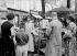 Painter in Montmartre, making a portrait from a model, place du Tertre. Paris (XVIIIth arrondissement), on August 4, 1954. © Roger-Viollet
