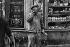 Man in front of a bakery, rue de Sèvres. Paris, 1963. Photograph by Janine Niepce (1921-2007). © Janine Niepce / Roger-Viollet